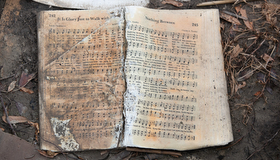 A waterlogged hymnal lies in the mud outside Wakefield United Methodist Church in Cameron, La., after Hurricane Laura destroyed the sanctuary. Photo by Mike DuBose, UM News.