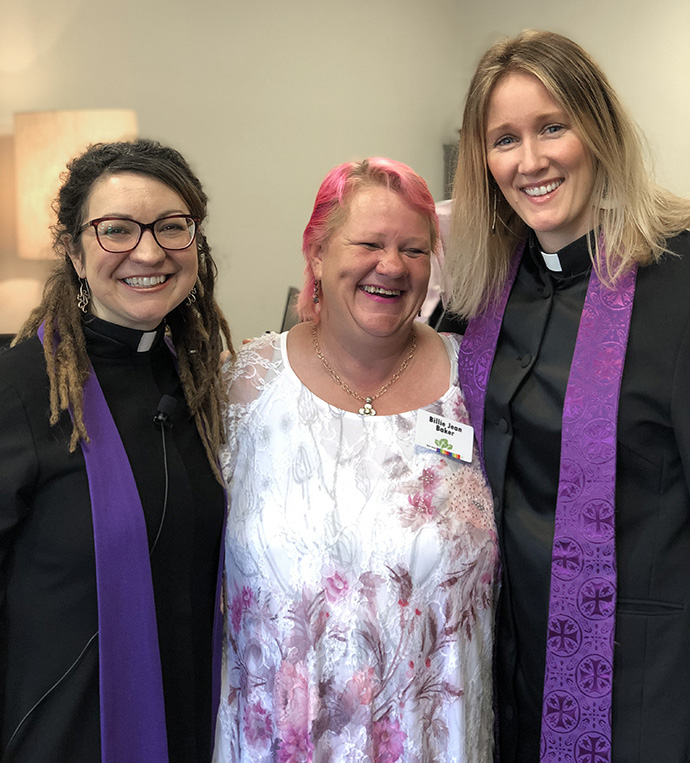 Billie Jean Baker is flanked by the Rev. Rachel Baughman (left) and the Rev. Mara Morhouse of Oak Lawn United Methodist Church, at a pre-pandemic gathering. Baker used to be homeless, and often slept outside the Dallas church. Baughman, senior pastor, credits Baker with helping lead Oak Lawn United Methodist to open its doors more widely to unsheltered persons. Photo courtesy of Oak Lawn United Methodist Church.