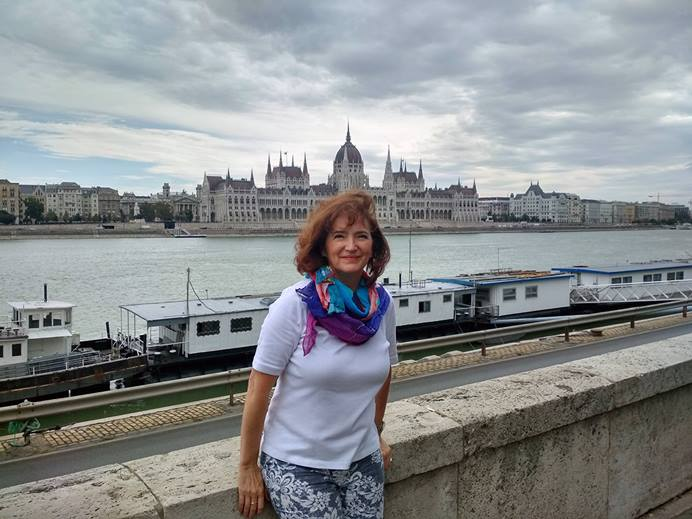 Györgyi Vályi followed the call to lead a small church in Budapest, Hungary, called Hope Church. Her ministry as a mission worker leading the church has come amid the COVID-19 pandemic. Portrait taken in front of the Parliament building by the Danube River. Photo courtesy of Györgyi Valyi.