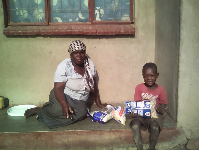 United Methodist Ruseni Yeni and her 6-year-old great-grandson, Junior, depend on well-wishers to get by during the COVID-19 pandemic. They were among the recipients of food aid distributed by The United Methodist Church in the Harare East District of Zimbabwe. Photo by Kudzai Chingwe, UM News.