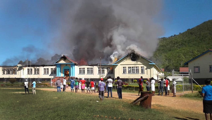 A fire partially destroyed United Methodist Hartzell High School on April 6, 2019. The Hartzell Old Student Association is helping replace some of the 40,000 books lost in the fire. File photo by Sengurayi Mashiri.