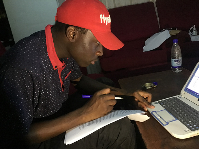 Tatenda Kambarami, 28, studies at his home during the COVID-19 lockdown. The pandemic has left many young people struggling to meet exam requirements and worried about their futures. Photo by Chenayi Kumuterera, UM News.