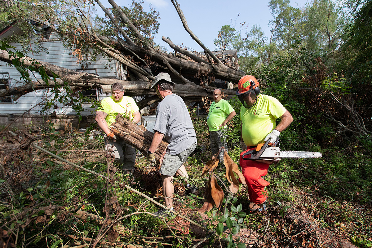 United Methodist volunteers work to remove a fallen tree from a home in DeRidder, La., in September after Hurricane Laura swept through the area. United Methodists along the Gulf Coast are responding to Hurricane Zeta, the 11th named storm to hit the U.S. so far this year. File photo by Mike DuBose, UM News.