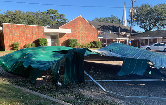 A metal roof lies outside Crawford United Methodist Church in Mobile, Ala., after it was blown across the highway by Hurricane Zeta. Photo courtesy of the Rev. Michele Statkewicz.