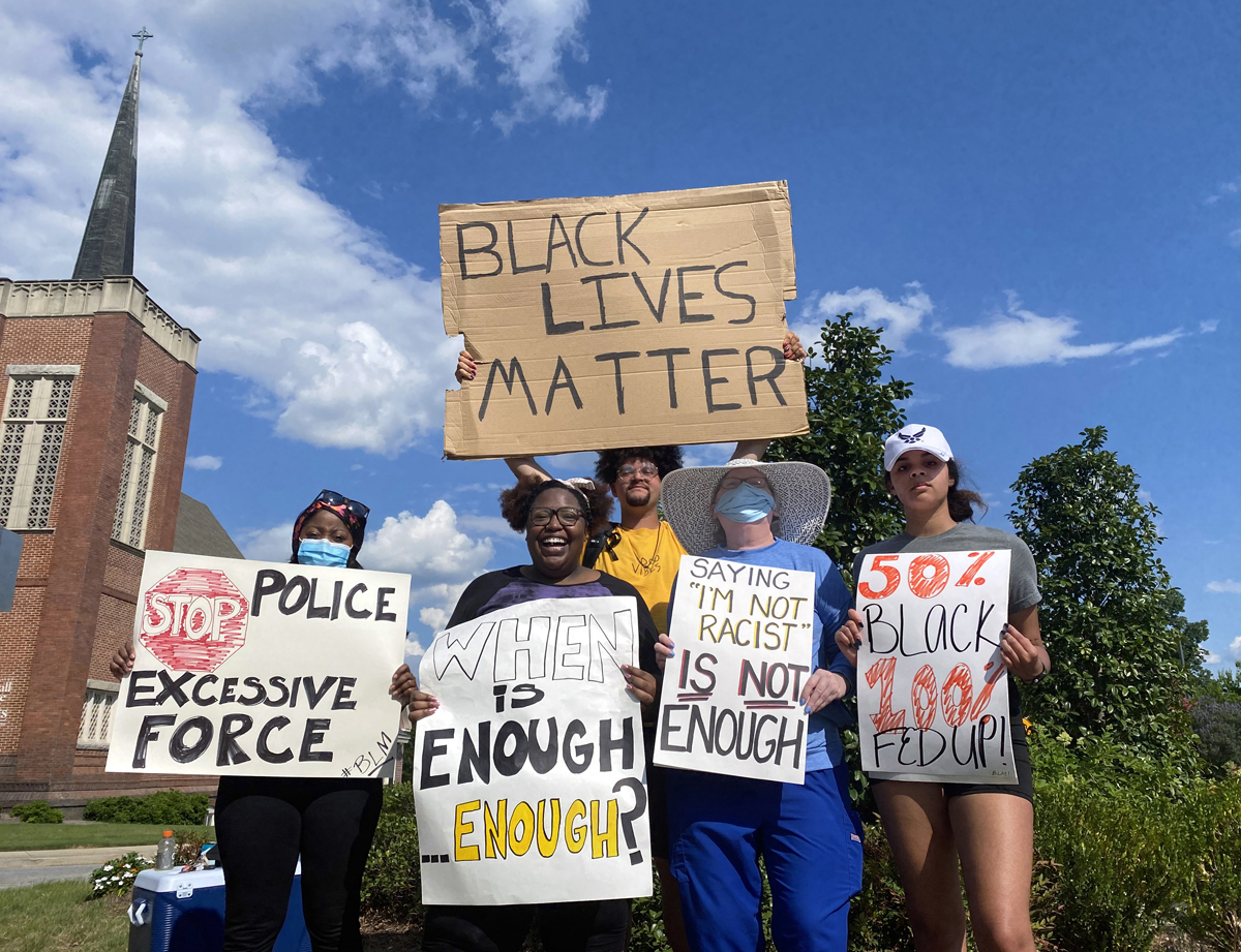 Derian Wilson, a member of Martha Bowman United Methodist Church in Macon, Ga., protests against racism regularly in that city. Wilson (at top in yellow shirt) and fellow activists during one of the three or four protests he leads each week. Photo courtesy of Derian Wilson.