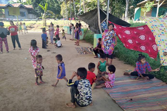 Women and children, many of them United Methodists, take shelter under the covered court of a local elementary school in the Arakan barangay of North Cotabato, Philippines. They fled their homes amid insecurity in the region. The families evacuated without clothes or other necessities, and The United Methodist Church in the Philippines is offering assistance. Photo courtesy of the Rev. Recto Baguio.
