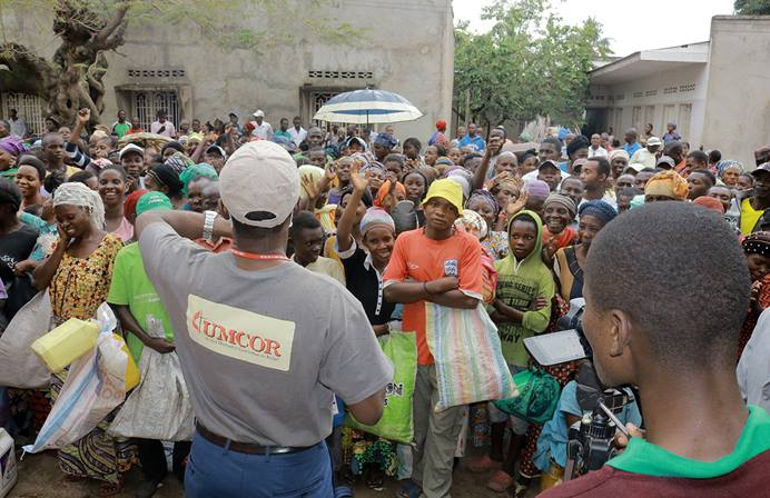 Jean Tshomba, coordinator of UMCOR's disaster management office in eastern Congo, speaks to the crowd before helping to distribute food and other items to more than 500 survivors of flooding in Uvira, Congo. Photo by Philippe Kituka Lolonga, UM News.