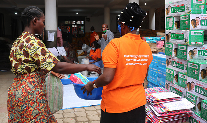 Ana Nyasile, who lost her husband during the recent floods in Uvira, Congo, receives food and other assistance from The United Methodist Church in East Congo through a grant from the United Methodist Committee on Relief. Photo by Philippe Kituka Lolonga, UM News.