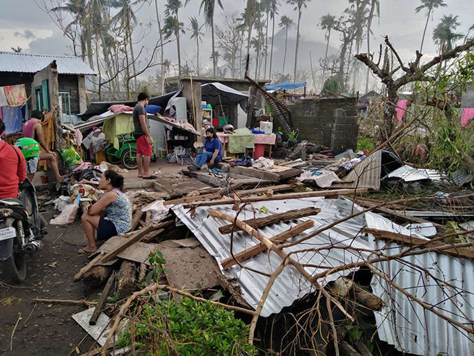 Survivors gather after Super Typhoon Rolly hit Tabaco City, Philippines. The storm damaged or destroyed the homes of six families who belong to The Living Stone United Methodist Church there. Photo courtesy of the Rev. Richie Grace Verganio.