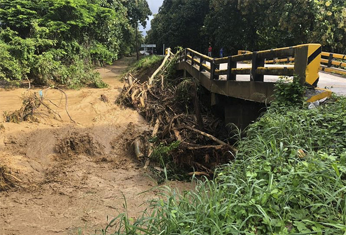 According to government authorities, Hurricane Eta severely affected Honduras' road infrastructure, leaving 21 bridges destroyed, like this one in Río Lindo, and more than 100 roads damaged. Photo courtesy of the United Methodist Mission of Honduras.