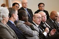 Kenneth Feinberg (holding microphone) speaks during a livestreamed panel discussion in Tampa, Fla., with members of the team that developed a new proposal that would maintain The United Methodist Church but allow traditionalist congregations to separate into a new denomination. The United Methodist Judicial Council expects to decide soon whether it has the jurisdiction to consider the constitutionality of legislation for a proposed plan for separating the denomination. File photo by Sam Hodges, UM News.