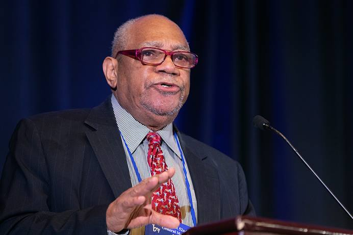 The Rev. William Bobby McClain speaks during the 2019 meeting of Black Methodists for Church Renewal in Atlanta. McClain, an original board member of the church's African-American caucus and professor emeritus at Wesley Theological Seminary in Washington, died Nov. 18. He was 82. File photo by Mike DuBose, UM News.