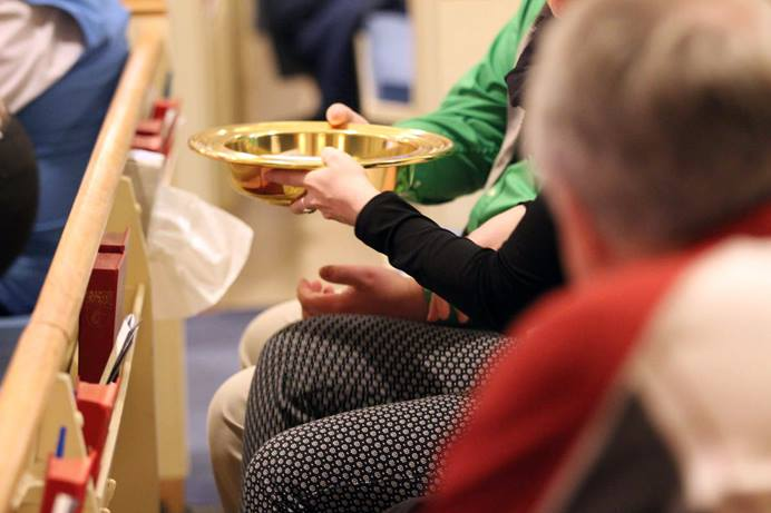An offering plate is passed down the pew at Cathedral of the Rockies, a United Methodist church in Boise, Idaho. The General Council on Finance and Administration board surveyed U.S. conference treasurers to find out what impact potential church disaffiliations and church closures will have on the apportionment formula over the next four years. 2018 file photo by Mary Kienzle, United Methodist Communications.