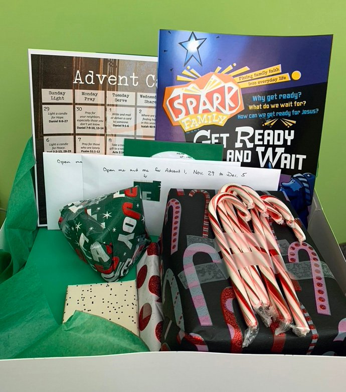 An Advent activity box created by Centennial United Methodist Church in Minnesota features goodies such as a Christmas CD and a Spark Family magazine for children, and activities including ornaments, prayers and an Advent wreath. Photo courtesy of the Rev. Jennifer Anderson, Centennial United Methodist Church.