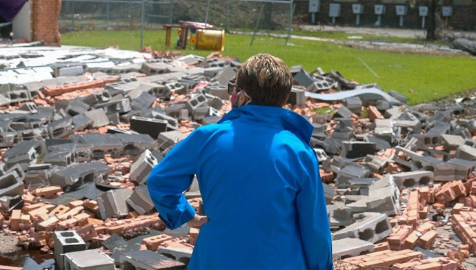 Bishop Cynthia Harvey surveys the rubble in front of University United Methodist Church in Lake Charles, La., after Hurricane Laura destroyed the nursery and an office wall. The church, which was hard hit by Hurricanes Laura and Delta, has been meeting at First United Methodist Church and will hold a service there on Dec. 23. Photo by Todd Rossnagel, Louisiana Conference.