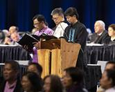Filipino Bishops Rodolfo A. Juan, Ciriaco Q. Francisco and Pedro M. Torio Jr. lead prayer during the 2019 Special Session of the United Methodist General Conference in St. Louis on Feb. 23. The Philippines Central Conference's coordinating council voted to extend the episcopal leadership of the three bishops through the end of 2021. File photo by Kathleen Barry, UM News.
