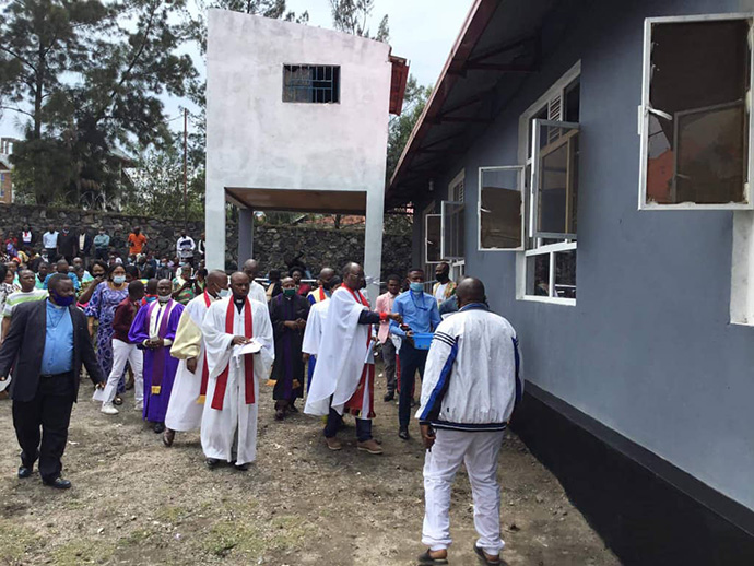 "East Congo Bishop Gabriel Yemba Unda blesses the new Amani United Methodist Church in Goma, Congo, in October. The church is the 33rd new church built in eastern Congo over the past eight years as part of Unda's ""Rise and Build"" evangelism campaign. Photo by Philippe Kituka Lolonga, UM News."