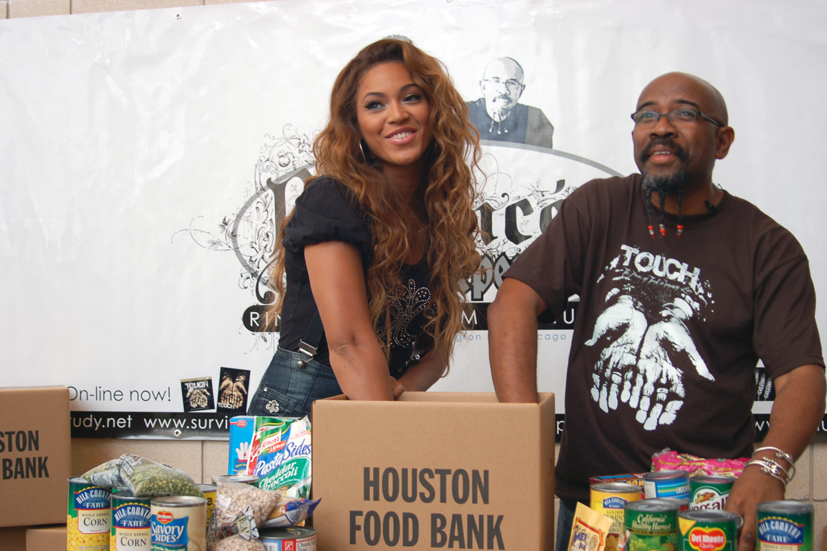 """The Rev. Rudy Rasmus, senior pastor at St. John's Downtown Church in Houston and editor of the book """"I'm Black. I'm Christian. I'm Methodist,"""" attends a food bank event with the singer Beyoncé, who grew up in that church. Photo courtesy of St. John's Downtown Church in Houston."""