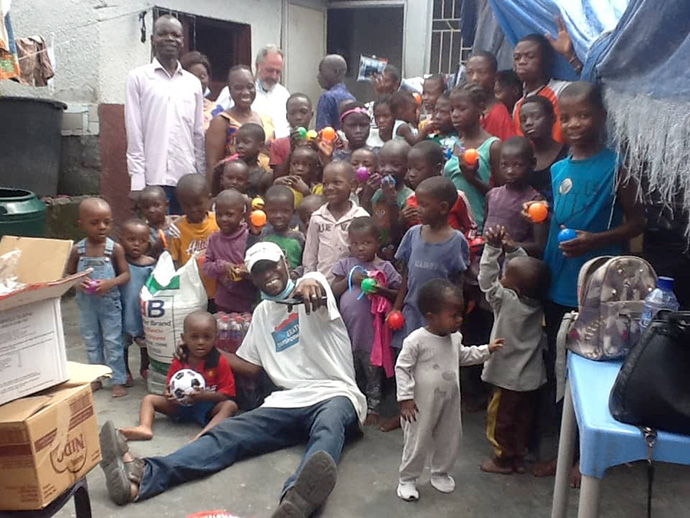United Methodist missionary Innocent Phrytoil Afful and children from the Kinkole Orphanage display gifts they received from a donor. Afful helps care for 475 children at the orphanage in Kinshasa, Congo. Photo courtesy of Innocent Phrytoil Afful.