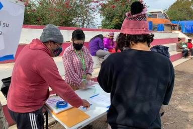 Cindy Andrade Johnson (center), a United Methodist deaconess, helps migrants living in a makeshift camp in Matamoros, Mexico, write letters to U.S. President-elect Joe Biden. Biden promised immigration reform during his presidential campaign. Photo courtesy of Cindy Andrade Johnson.