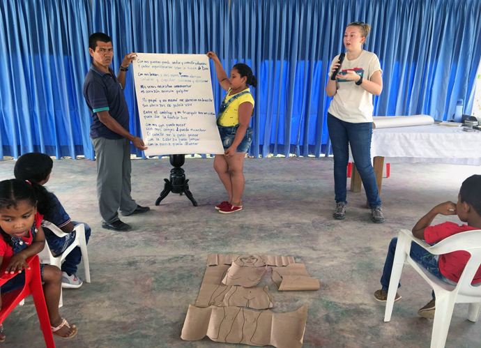 Hannah Reasoner (in white T-shirt facing camera) instructs children as part of her duties as a missionary in Colombia. Photo courtesy of Hannah Reasoner.