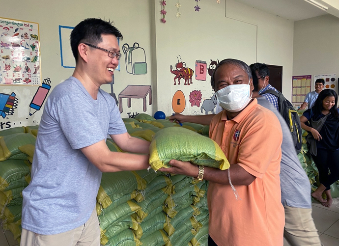 The Rev. Andrew Lee (left) has witnessed hardships related to the coronavirus while serving as a missionary in Cambodia, especially for the poor and marginalized. Lee has helped distribute a 10 kilogram-sack of rice, soaps, reusable masks and sanitize to those suffering hardship during the COVID pandemic. Photo courtesy of the Rev. Andrew Lee.