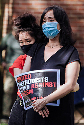 "A woman holds a sign saying, ""United Methodists stand against racism,"" during a Black Lives Matter rally in Willingboro, N.J., on Sunday, June 7, at St. Paul United Methodist Church. File photo by Aaron Wilson Watson."
