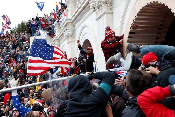 Supporters of President Donald Trump storm into the U.S. Capitol in Washington after clashing with police to protest the certification of the 2020 U.S. presidential election results by Congress on Jan. 6. Photo by Shannon Stapleton, REUTERS.