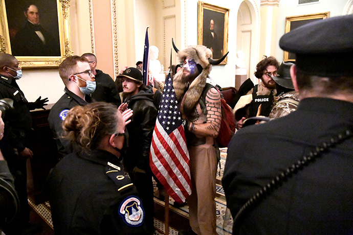 Police confront supporters of President Donald Trump as they demonstrate on the second floor of the U.S. Capitol in Washington near the entrance to the Senate after breaching security defenses on January 6. Photo by Mike Theiler, REUTERS.