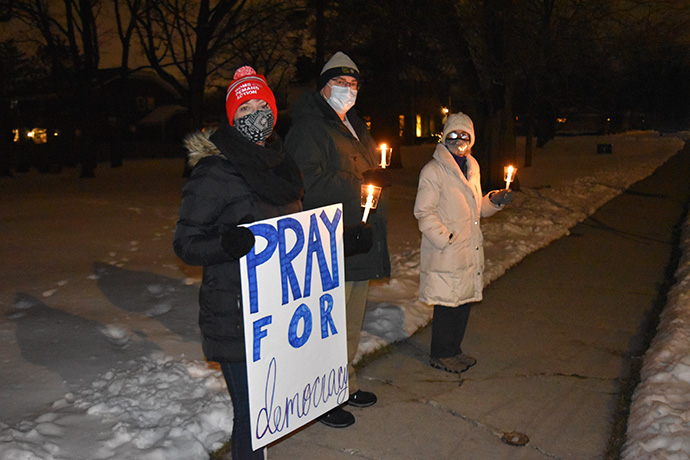 People at First United Methodist Church in Arlington Heights, Ill., hold candles during a prayer vigil in reaction to violence at the U.S. Capitol. Photo by Anne Marie Gerhardt, Northern Illinois Conference.