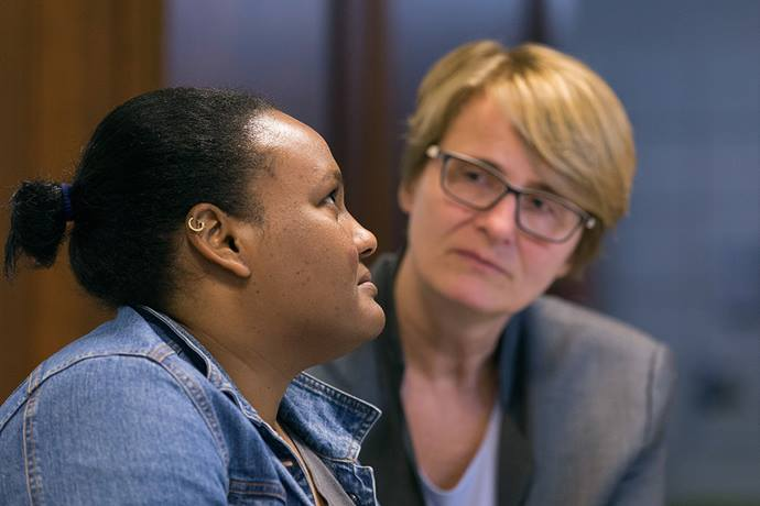 The Rev. Susanne Nießner-Brose (right) listens while a 27-year-old Sudanese woman who asked that she be called Fatima relates her story of fleeing Sudan to seek religious freedom in Europe. She was taking asylum in 2017 at the United Methodist Church of the Redeemer in Bremen, Germany, where Nießner-Brose is pastor, and was later accepted as a refugee. File photo by Mike DuBose, UM News.