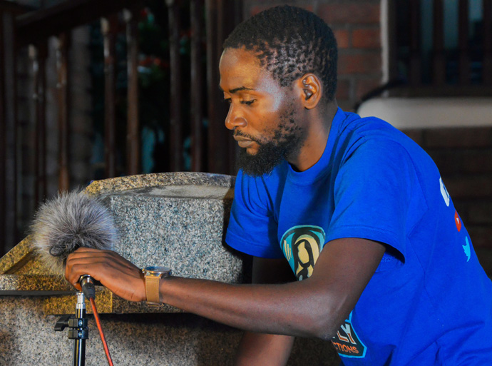 Rutendo Luckmore Kufarimayi of Cranborne United Methodist Church in Harare, Zimbabwe, sets up a professional microphone covered with a windscreen to capture sound for the video camera. Photo courtesy of Rutley Productions, a YouTube Channel offering United Methodist-related videos.