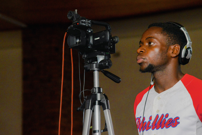 Videographer Walter Tumba monitors the camera to keep the subject centered in the viewfinder while taping at Cranborne United Methodist Church in Harare, Zimbabwe. Photo courtesy of Rutley Productions, a YouTube Channel offering United Methodist-related videos.