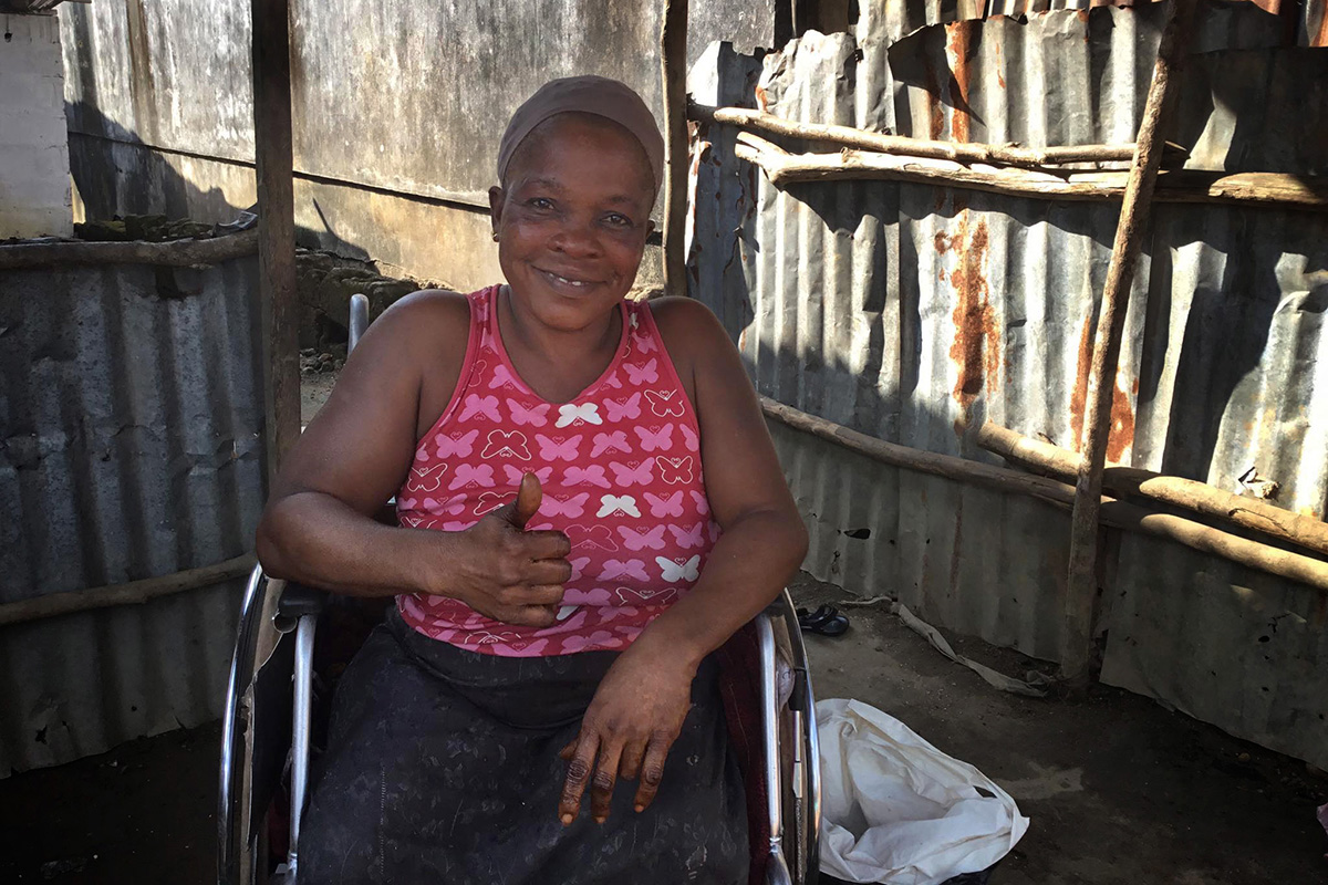 Alice M. Nyankolor expresses her appreciation for the new wheelchair she received thanks to Asbury United Methodist Church in Allentown, Pa., in cooperation with Healthy Women, Healthy Liberia's Waterfield Primary Healthcare Center in Kakata, Liberia. Photo by E Julu Swen, UM News.