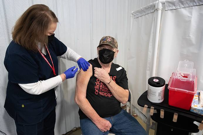 Stephen Saucerman receives a COVID-19 vaccination from volunteer nurse Jackie Smith, RN, at Community United Methodist Church in Vincennes, Ind. Photo by Mike DuBose, UM News.