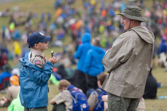 "A Scout shows his copy of the United Methodist devotional guide ""Strength for Service"" to an adult leader at the 2017 National Scout Jamboree at the Summit Bechtel Reserve in Glen Jean, W.Va. The General Commission on United Methodist Men supports Scouting and publishes the ""Strength for Service"" devotional series. File photo by Mike DuBose, UM News."
