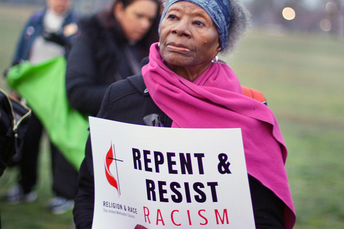 A woman holds a sign during an April 4, 2018, peace and unity rally. The rally followed the United Methodist Commission on Religion and Race's participation in the United to End Racism Prayer Walk in Washington. File photo courtesy of the Commission on Religion and Race.