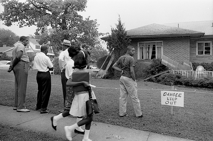 African Americans view the bomb-damaged home of Arthur Shores, an attorney for the NAACP, in Birmingham, Ala., in 1963. Photo by Marion S. Trikosko, U.S. News and World Report Magazine Photograph Collection/Library of Congress.