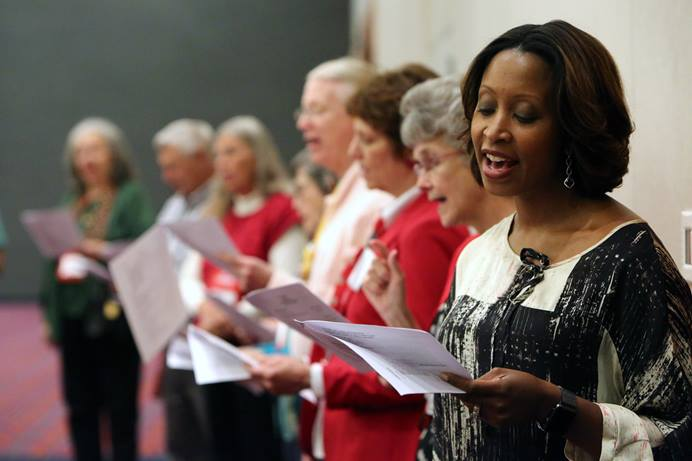 The Rev. Andrea Davidson sings during the May 20 communion service at the 2016 United Methodist General Conference in Portland, Ore. File photo by Kathleen Barry, UM News.
