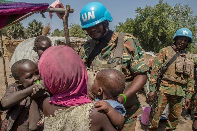 United Nations peacekeepers from Zambia visit with a family while on patrol in the Central African Republic in February, 2020. Following a volatile presidential election there, United Methodists are offering humanitarian aid to people seeking refuge from armed rebels. File photo by Hervé Serefio, United Nations.