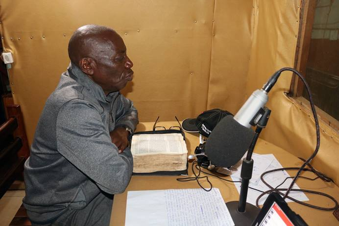 The Rev. Clement Kingombe Lutala, Bukavu District superintendent, shares COVID-19 prevention information on Radio Iriba in Bukavu. With the help of the United Front Against Riverblindness, The United Methodist Church in East Congo has led awareness campaigns via community radio in 10 health zones in North and South Kivu. Photo By Philippe Kituka Lolonga, UM News.