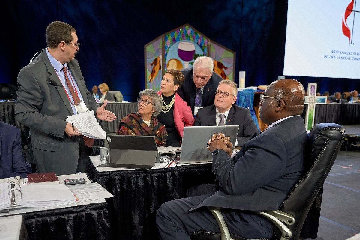 Following the announcement of a Judicial Council ruling that found several parts of the Traditional Plan unconstitutional, church officials confer during a pause in the Feb. 26 plenary session of the 2019 General Conference in St. Louis. Photo by Paul Jeffrey, UM News.