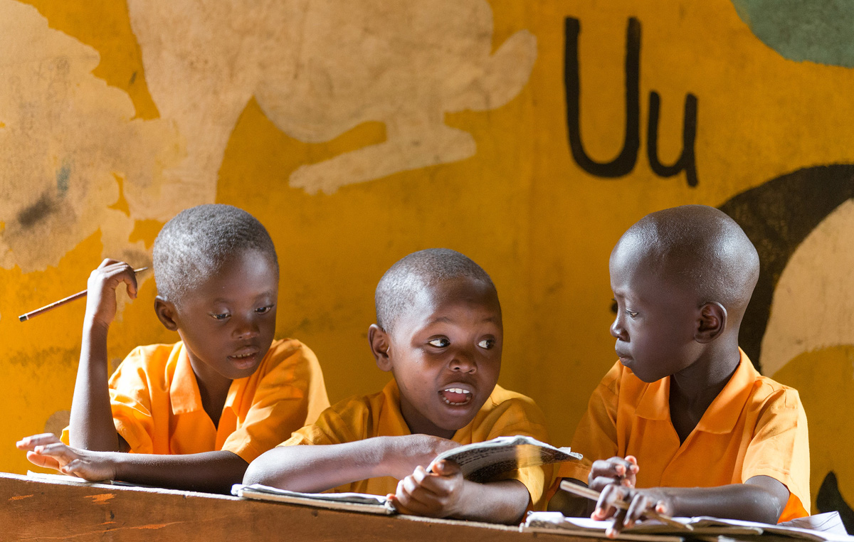 Students work together on spelling words in the combined kindergarten and first grade classroom at the Bishop Judith Craig Children's Village in Duahzon, Liberia. 2017 file photo by Mike DuBose, UM News.