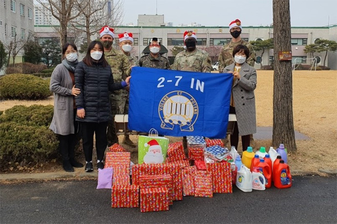 Soldiers at U.S Army Garrison Humphreys in Pyeongtaek, South Korea, pose with Christmas gifts they collected for Jacob's House, a local orphanage. Photo courtesy of the Rev. DooSoo Lee, U.S. Army.