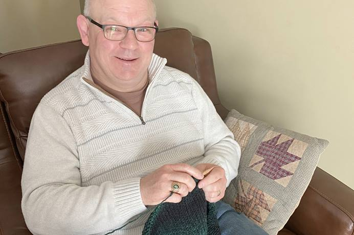 The Rev. Chad Parmalee has found knitting, especially making items for others, a way to relax amid the stresses of pandemic ministry. Parmalee leads Chapel Hill United Methodist Church in Battle Creek, Mich. Photo by Roschenne Parmalee.