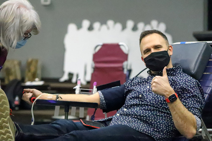 The Rev. Aaron Brown, pastor of Saint Paul's United Methodist Church in Joplin, Missouri, makes a blood donation. Brown says he's been sure to get exercise and continue consulting with a personal coach and spiritual director through this pandemic year. Photo courtesy of Saint Paul's United Methodist Church.