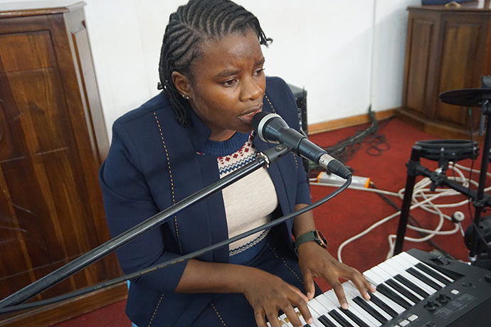 "Christine Anesu Hove records music for an online worship service at Chisipiti United Methodist Church in Harare, Zimbabwe. ""I eat, breathe and speak music,"" Hove said, ""and that is how I am fulfilling my calling during this COVID-19 pandemic."" Photo by Kudzai Chingwe, UM News."