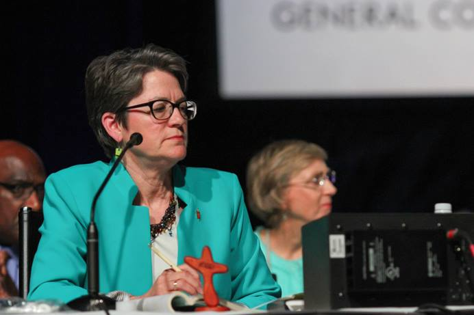 Bishop Sally Dyck presides over a discussion of the church budget during the 2016 United Methodist General Conference in Portland, Ore. After the 2020 General Conference was delayed, the board of the denomination's finance agency asked the United Methodist Judicial Council for a declaratory decision on how to calculate the ongoing denominational budget and apportionment formula. File photo by Maile Bradfield, UM News.