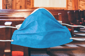 Churches are adopting safety protocols as they open for modified services during Holy Week. Pews by Andrew Seaman, courtesy of Unsplash; mask image courtesy of Pixabay.