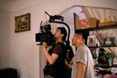 """Gordon Yu (left) and Julian Kim record a scene for the film """"Happy Cleaners,"""" which examines the lives of working-class Korean Americans. Photo by Janice Chung."""